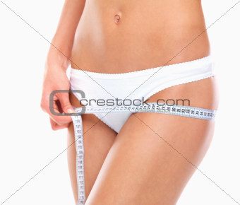 Woman measuring hips