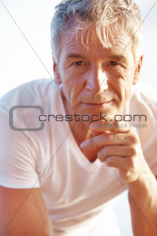 Handsome mature man looking at you confidently
