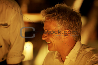 Closeup of mature man at restaurant smiling