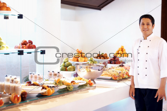 Professional chef at buffet food party