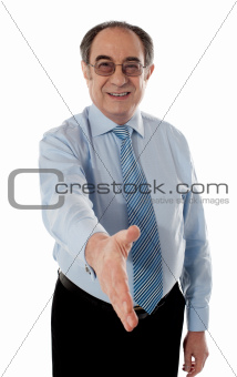 Confident modern businessman offering handshake