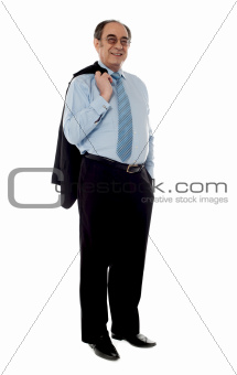 Senior businessman holding coat over his shoulders