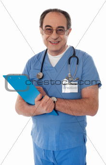 Experienced doctor smiling at camera