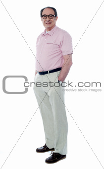 Side view of senior man posing in style