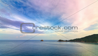 Small island and colorful sky