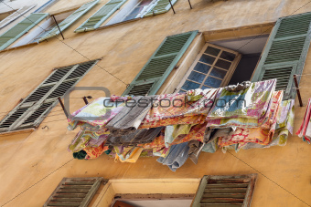 drying laundry outside the window