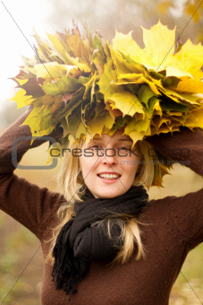 Woman with autumn wreath outdoors