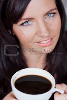 Beautiful woman enjoying cup of coffee
