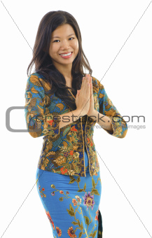 Asian woman gestures welcoming