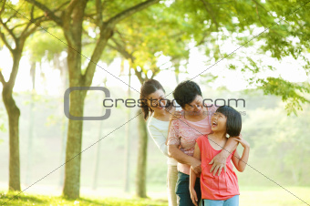 Grandmother, mother and grandchild