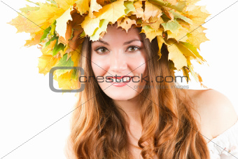 Beautiful fall woman. close up portrait of girl with  autumn wreath of maple leaves