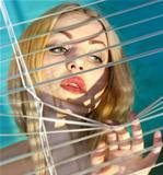 woman looking through jalousie l