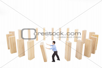 businessman pushing  down the wall in circle.