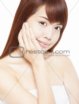 Close up portrait of beautiful asian woman's face with hand