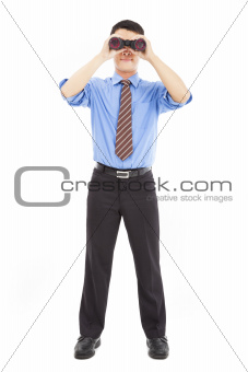 full length of businessman looks through binoculars and isolated