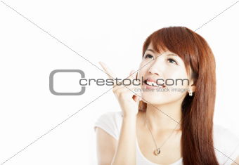 happy young  woman pointing at something