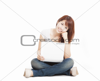 Smiling young woman with a laptop and isolated on white