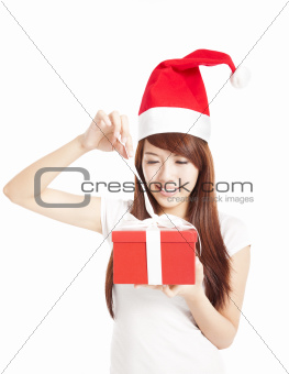 young woman trying to open christmas gift box