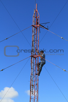 Radio Tower Worker Climbing on a Tower