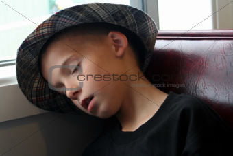 Boy Asleep In Booth