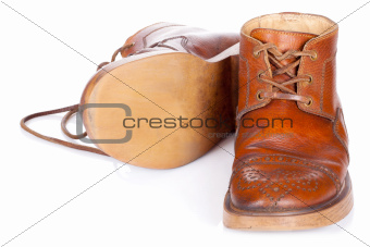 Red old leather boots isolated on white background