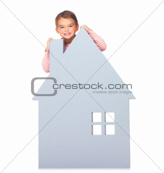 Cute little kid with a big home sign isolated on white