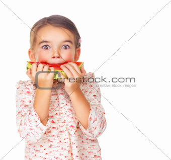 Little girl enjoying delicious watermelon on white