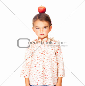 Serious looking girl with an apple on head 