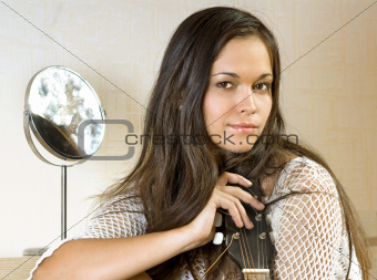 face of woman with guitar