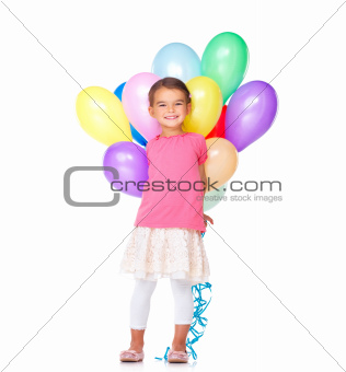 Cute little girl holding colorful balloons on white