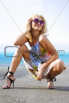 happy blond on coast