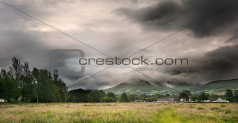 Countryside landscape image across to mountains in distance