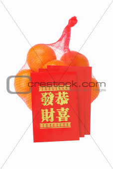 Chineses New Year Red Packets and Oranges