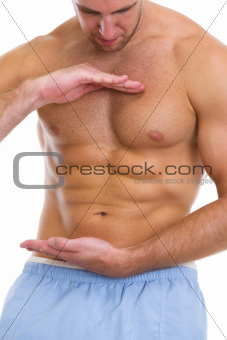 Closeup on male athlete showing great abdominal muscles