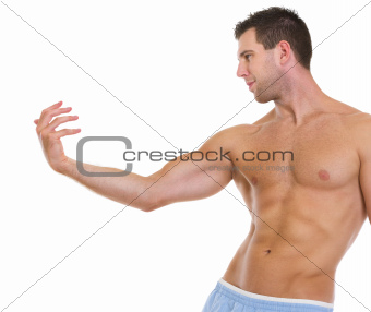 Fitness man with muscular body gracefully posing