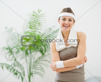 Portrait of happy woman in sportswear with towel