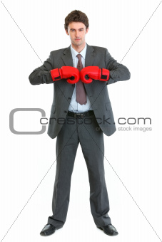 Full length portrait of businessman in boxing gloves