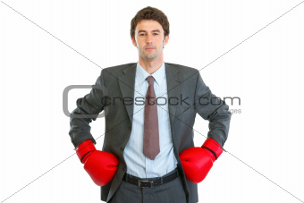Serious businessman in boxing gloves