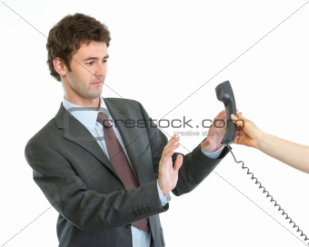Concerned businessman refusing answer phone call