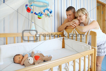 Parents near baby's bed