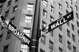 Street signs indicating the intersection of Wall Street and Broadway.