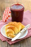 croissant with jam on a plate -  French breakfast
