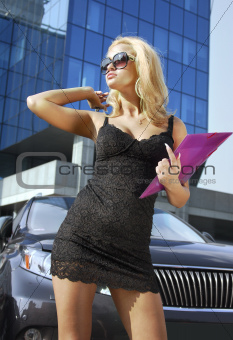 blonde businesswoman with purple folder