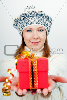 Attractive girl gives a wrapped gift