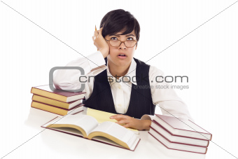 Bored Mixed Race Female Student at Desk with Books Isolated on a White Background.