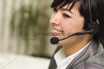 Attractive Young Mixed Race Woman Smiles Wearing Headset in Office Setting.