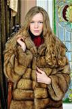 beautiful woman in fur coat in the luxurious antique interior.