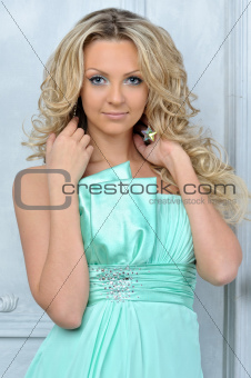 Beautiful blonde woman in a blue dress.