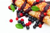 pancakes rolled in a tube with berries