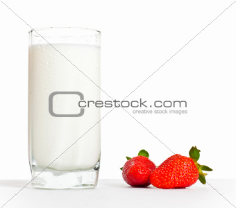 glass of milk and two strawberries